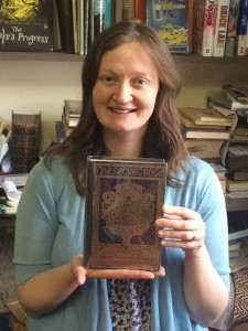 Tanya from Broadford Books with the first edition of The Secret Rose