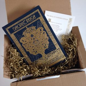 Book, signed dedication, personal card, wrapped in gold foil